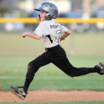 A picture of a kid running bases.